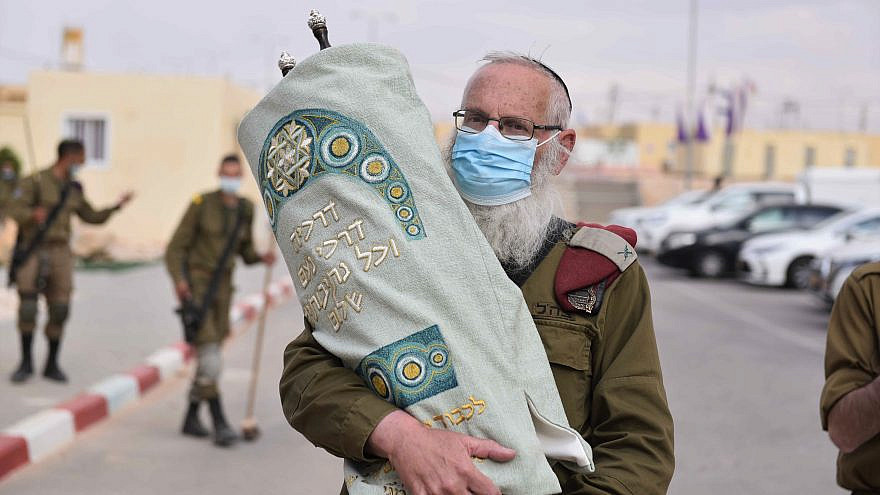 Brig. Gen. Eyal Karim, chief rabbi of the Israel Defense Forces, holds a new Torah scroll for use by the Tomer division of the Givati Brigade, Feb. 17, 2021. Credit: IDF.