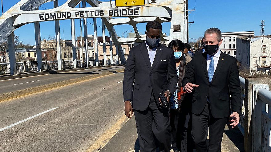 "Israeli Ambassador to the United States Gilad Erdan talks with David Jackson of the Philos Project while crossing the Edmund Pettus Bridge, site of the 1965 ""Bloody Sunday"" civil-rights demonstrations. Credit: Southern Jewish Life."