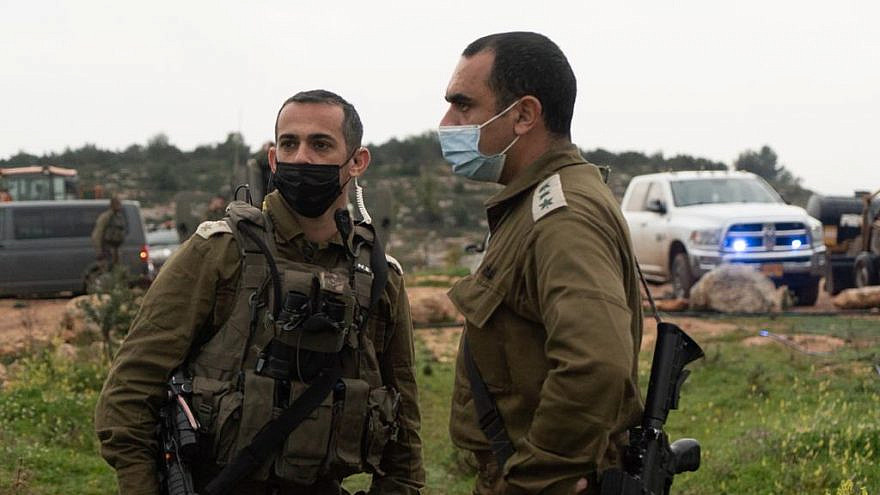 IDF Ephraim Regional Brigade commander Col. Yiftach Nurkin and Duchifat Battalion commander Lt. Col. Nir Ifergan asses the scene of a suspected terror attack at Sde Ephraim Farm in Judea and Samaria, Feb. 5, 2021. Credit: IDF.