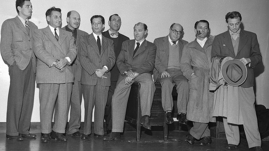 Nine Hollywood men charged with contempt of Congress give themselves up to the U.S. marshal on Dec. 10, 1947. From right: Ring Lardner Jr., John Howard Lawson, Alvah Bessie, Albert Maltz, Herbert Biberman, Lester Cole, Samuel Ornitz, Edward Dmytryk and Robert Adrian Scott.