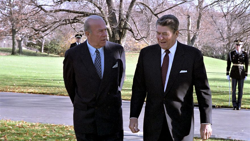 U.S. President Ronald Reagan with Secretary of State George Shultz outside the Oval Office on Dec. 4, 1986. Credit: Reagan White House Photographic Collection via Wikimedia Commons.