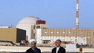Iranian President Hassan Rouhani (left) and head of the Atomic Energy Organization of Iran (AEOI) Ali Akbar Salehi near the Bushehr nuclear plant, on Jan. 13, 2015. Credit: Hossein Heidarpour via Wikimedia Commons.