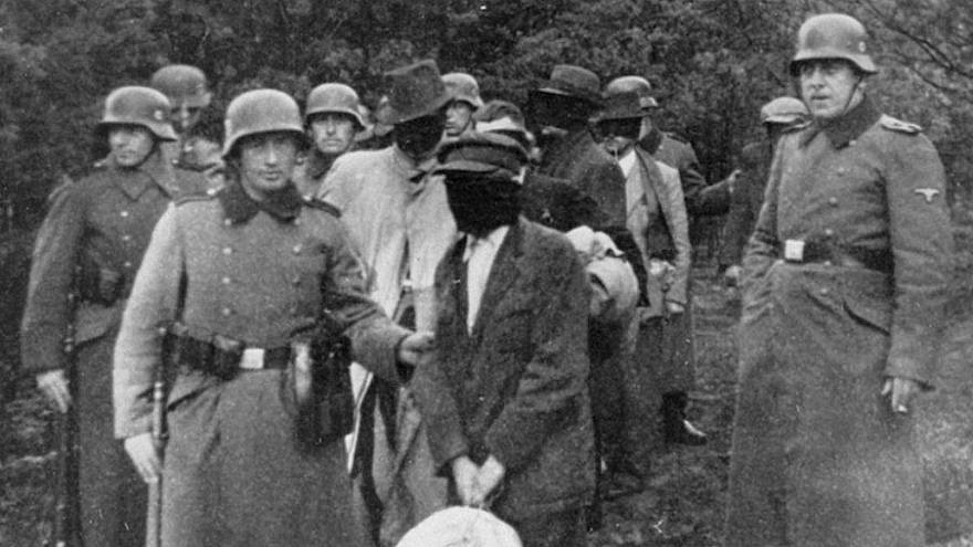 German SS lead blindfolded Polish prisoners to an execution site near Warsaw. Credit: United States Holocaust Memorial Museum.