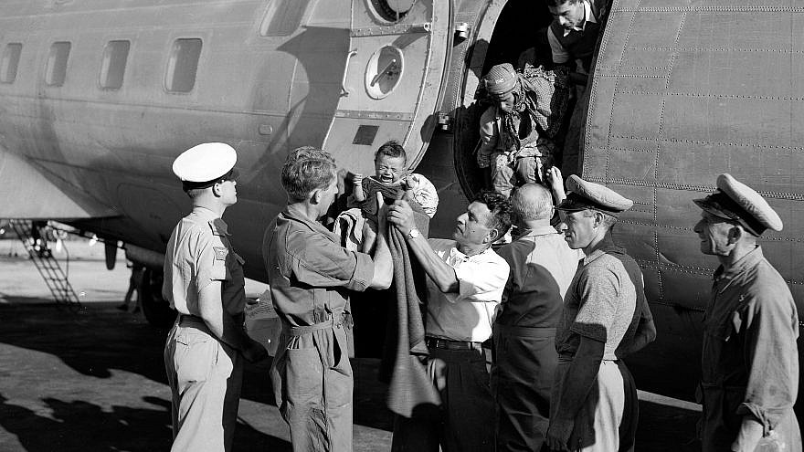 Yemenite immigrants being greeted by Jewish Agency representatives at Israel's Lod Airport in 1949. Credit: National Photo Collection/Government Press Office.