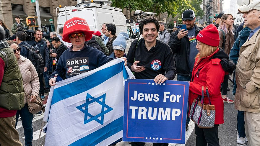 Supporters of President Donald J. Trump demonstrate during Veterans Day Parade's opening ceremony at Madison Square Park in 2019. Credit: Lev Radin/Shutterstock.