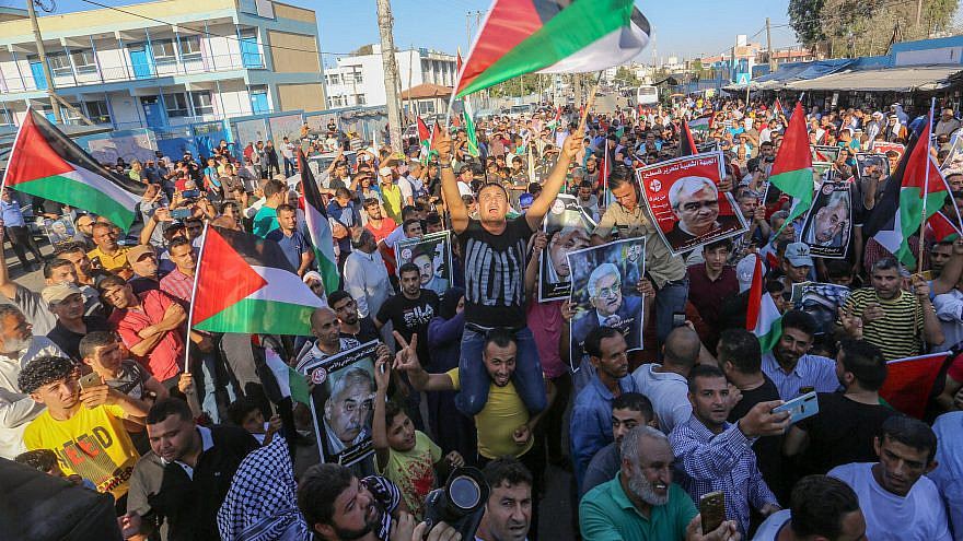 Palestinian supporters of the Fatah movement march in support of the joint conference between Hamas and Fatah in Ramallah against plans by Israel to apply sovereignty to part of the West Bank on July 2, 2020. Credit: Abed Rahim Khatib/Shutterstock.