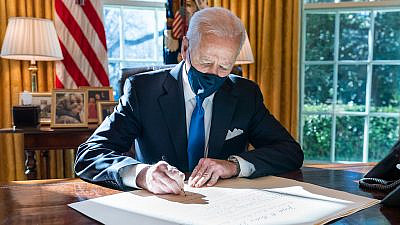 U.S. President Joe Biden signs a commission for Gina Raimondo as Secretary of Commerce, March 3, 2021. Credit: Official White House Photo by Adam Schultz.