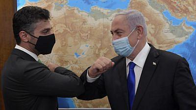Mohammed Fateh Ali Al Khaja (left), the United Arab Emirates' first ambassador to Israel, meets Israeli Prime Minister Benjamin Netanyahu in Jerusalem on March 2, 2021. Credit: Koby Gideon/GPO.