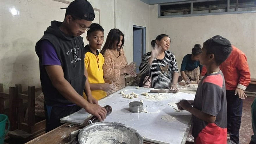 Members of the Bnei Menashe community in India make matzah prior to Passover, March 2021. Credit: Samuel Suantak, courtesy of Shavei Israel.