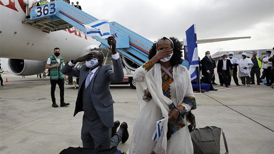"""Ethiopian immigrants arrive at Ben-Gurion International Airport on the final flight of """"Operation Tzur Israel"""" on March 11, 2021. Photo by Olivier Fitoussi."""