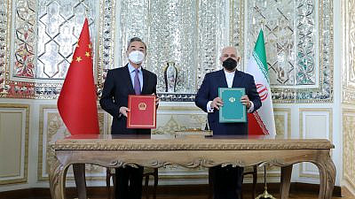 Chinese Foreign Minister Wang Yi and Iranian Foreign Minister Javad Zarif following the signing of a 25-year strategic cooperation agreement. Source: Javad Zarif/Twitter.