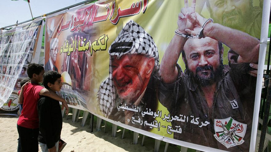 Palestinian children look at the image of PLO chief Yasser Arafat and terrorist Marwan Barghouti during a demonstration in the southern Gaza Strip calling for the release of prisoners held in Israeli jails on Oct. 6, 2011. Photo by Abed Rahim Khatib/Flash90.