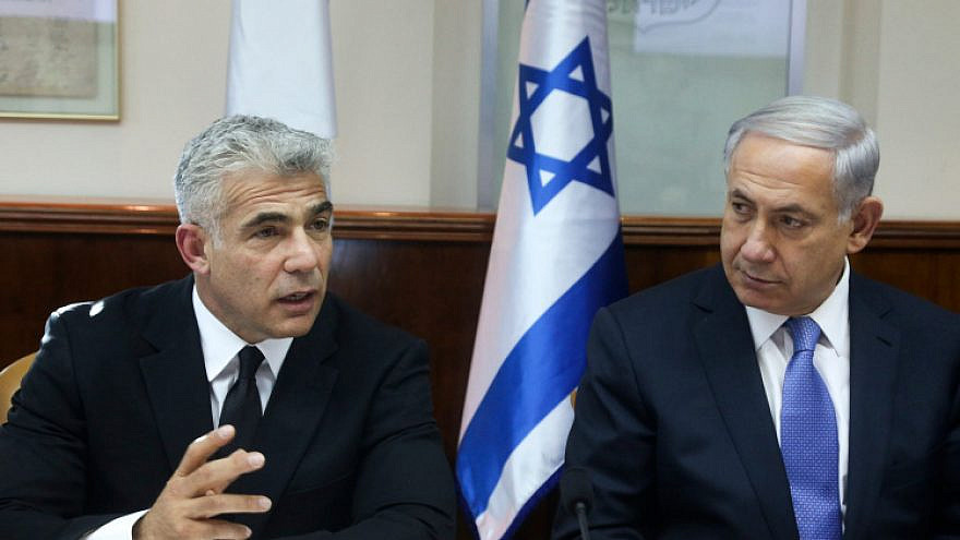 Israeli Prime Minister Benjamin Netanyahu Finance Minister Yair Lapid at a cabinet meeting on October 7, 2014. Photo by Marc Israel Sellem/POOL/Flash90.