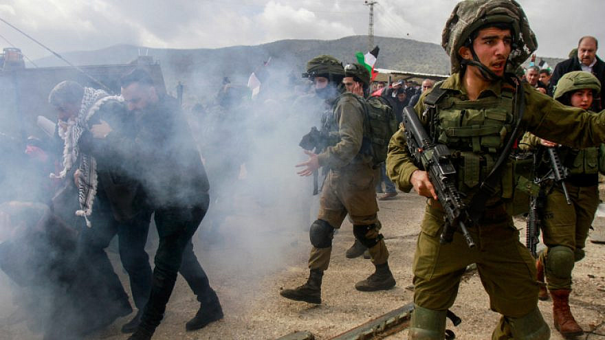 Palestinians clash with Israeli soldiers near the town of Tubas in Judea and Samaria, during a demonstration against U.S. President Donald Trump's peace proposal on on Jan. 29, 2020. Photo by Nasser Ishtayeh/Flash90.