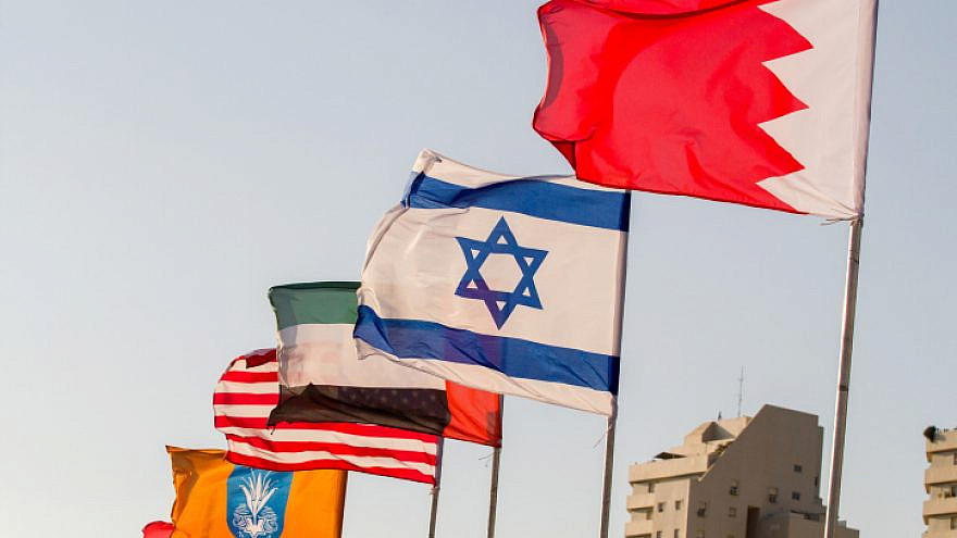 The flags of the United States, the United Arab Emirates, Israel and Bahrain on the side of a road in Netanya on Sept. 14, 2020. Photo by Flash90.