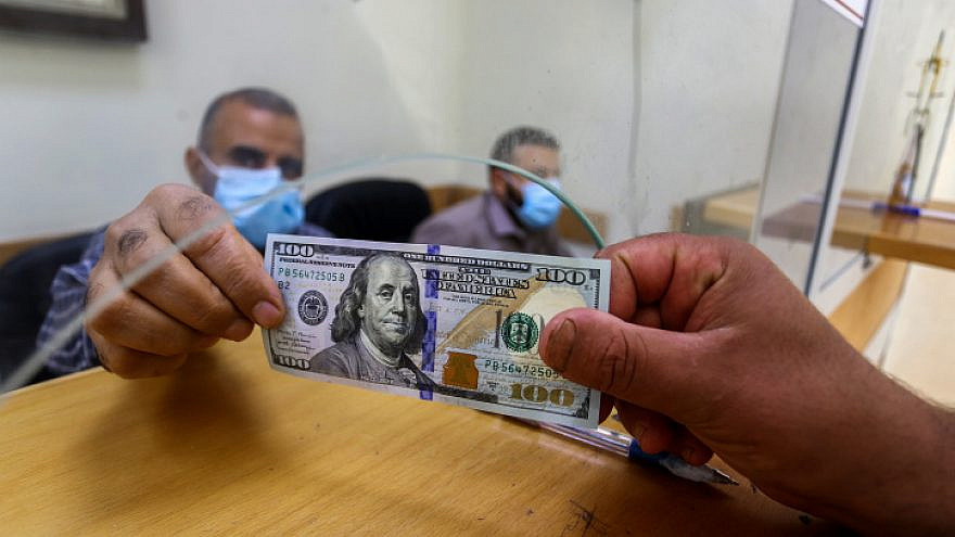 Palestinians receive financial aid from Qatar at a post office in Rafah in the southern Gaza Strip on Oct. 6, 2020. Photo by Abed Rahim Khatib/Flash90.