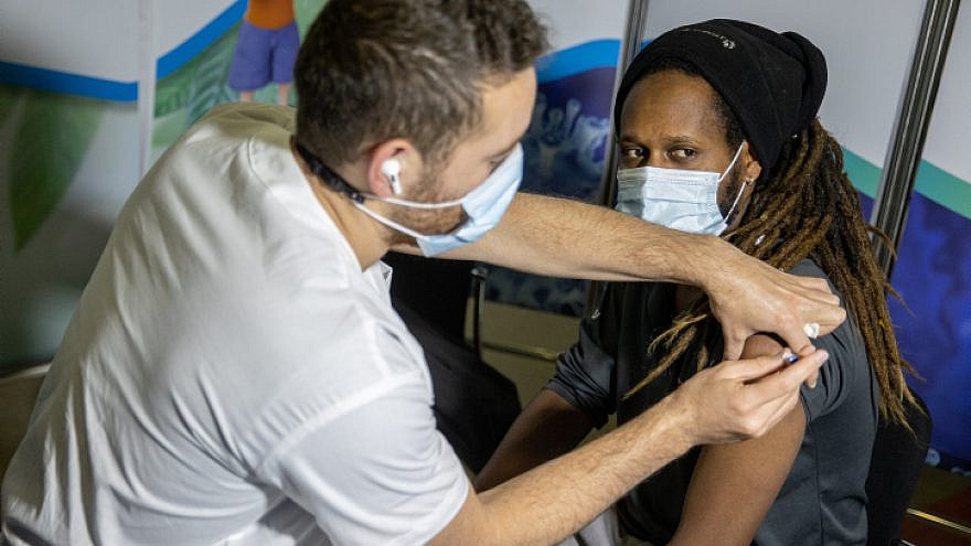 A COVID-19 vaccine is administered at a vaccination center in Jerusalem on March 11, 2021. Photo by Yonatan Sindel/Flash90.