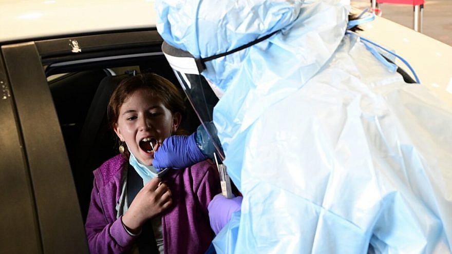 Coronavirus testing near the northern Israeli town of Katzrin in the Golan Heights, on Feb. 21, 2021. Photo by Michael Giladi/Flash90.