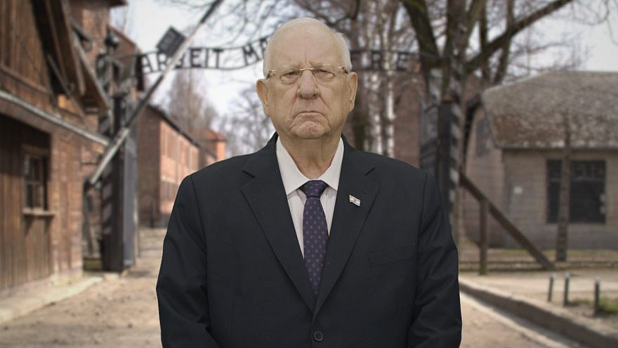 Israel's President Reuven Rivlin in front of the virtual gates to Auschwitz as part of the 2021 March of the Living online event. Credit: Office of the President for March of the Living.