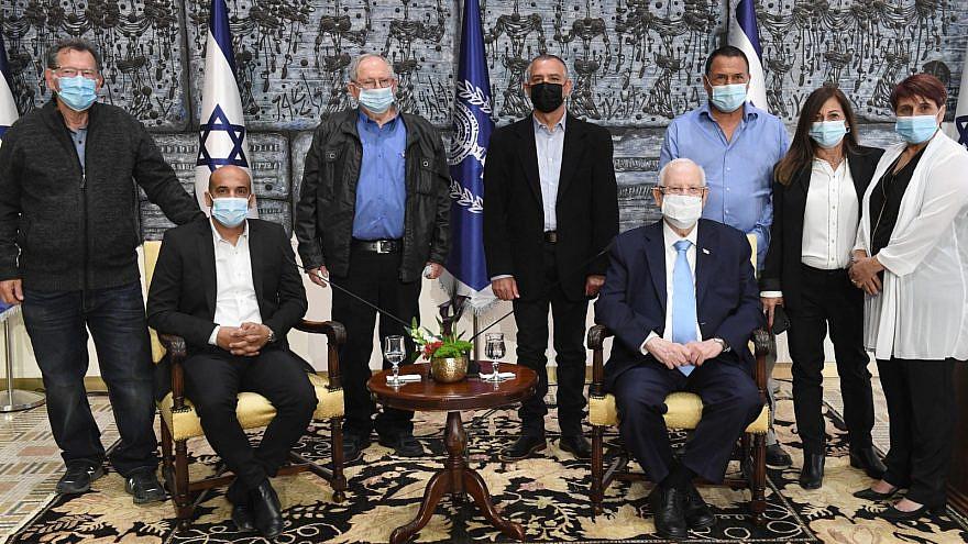 Israel's President Reuven Rivlin (seated, right) celebrates 100 years of the Israeli Moshavim Movement at Beit HaNasi, March 8, 2021. Credit: Mark Neyman/GPO.