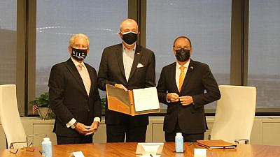 From left: New Jersey Institute of Technology president Joel Bloom, New Jersey Gov. Phil Murphy and president Daniel Chamovitz of Ben-Gurion University of the Negev sign an MoU to create the joint Institute for Future Technologies at the Choose New Jersey offices in Newark, N.J, on March 16, 2021. Credit: Courtesy.