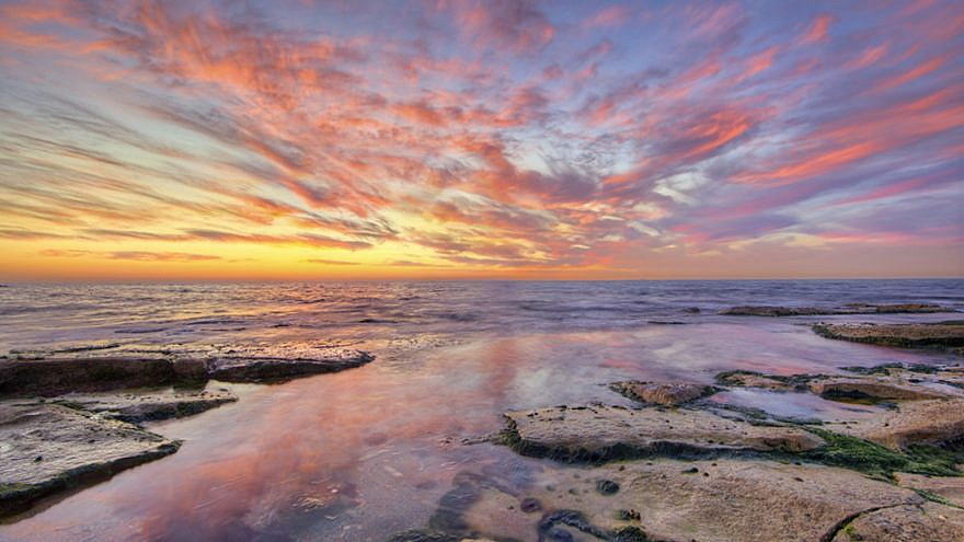 A romantic scene on a Nahariya beach. Photo by Noam Chen.