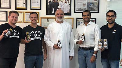 From left: Co-founder of D'vash Organics David Czinn; D'vash Organics co-founder and CEO Brian Finkel; Mohamed Saleem, founder and owner of Al Barakah; Yousuf Saleem, Mohamed's older son and managing director of Al Barakah; and Mohamed's younger son, Abdulkarim Saleem. Photo by Mubarak Taj.