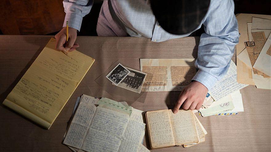 Writer and researcher Dovid Zaklikowski takes notes from archival documents, 2020. Photo by Menachem Serraf/Hasidic Archives.