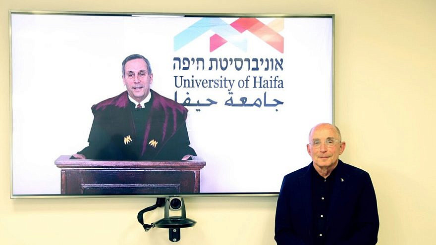 Harvard University president Lawrence Bacow receives an honorary doctorate from University of Haifa president Ron Robin, March 15, 2021. Credit: University of Haifa.