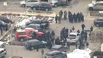 Police officers and SWAT teams on the scene after a mass shooting at a supermarket in Boulder, Colo., on March 23, 2021. Source: Screenshot.