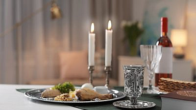 A Passover table setting. Credit: New Africa/Shutterstock.