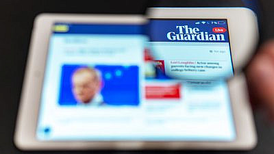 """The Guardian News"" website homepage on a tablet. Credit: Anton Garin/Shutterstock."