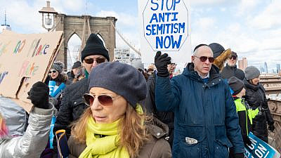 "Thousands of people cross the Brooklyn Bridge as part of the ""No Hate, No Fear"" Jewish Solidarity March in January 2020 in response to anti-Semitic attacks in and around New York City. Credit: Lev Radin/Shutterstock."