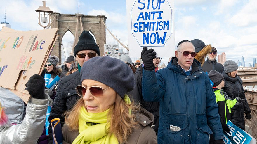 """Thousands of people cross the Brooklyn Bridge as part of the """"No Hate, No Fear"""" Jewish Solidarity March in January 2020 in response to anti-Semitic attacks in and around New York City. Credit: Lev Radin/Shutterstock."""