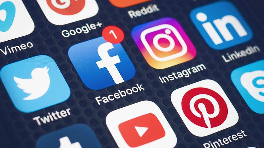Illustrative: Social-media companies displayed on a smartphone. Credit: Twin Design/Shutterstock.