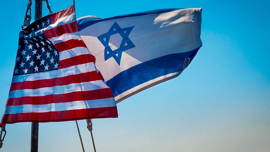 American and Israeli flags flying together. Credit: John Theodor/Shutterstock.