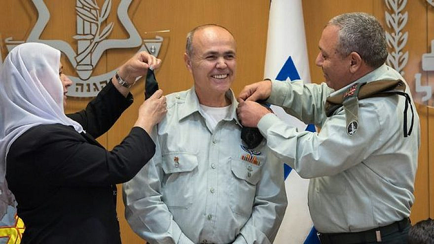 Kamil Abu Rokon receives the rank of major general from IDF Chief of Staff Gadi Eisenkot, right, and Abu Rokon's wife in a ceremony at IDF headquarters in Tel Aviv on March 29, 2018. Credit: IDF Spokesperson's office.