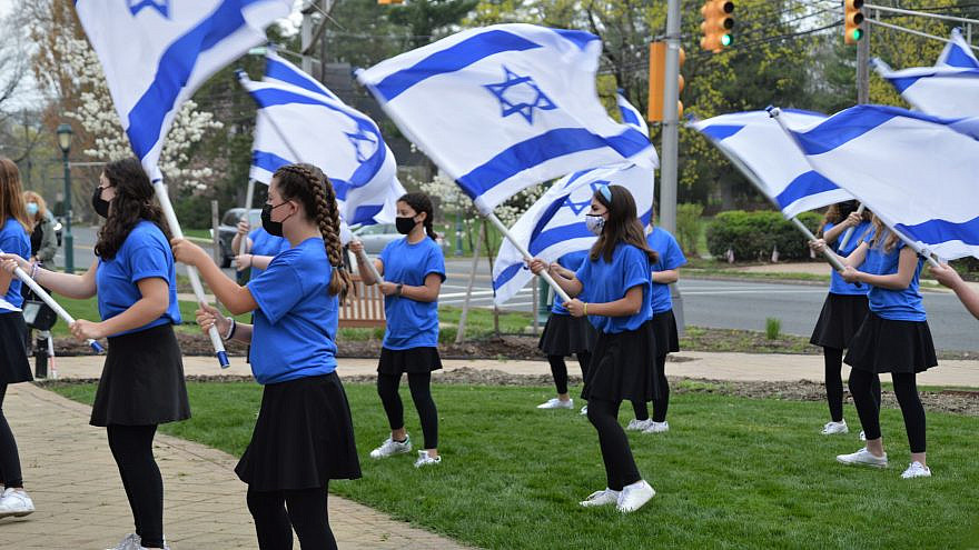 Students from the Joseph Kushner Hebrew Academy perform an Israeli flag routine at a Yom Ha'azmaut event in Livingston, N.J., on April 15, 2021. Photo by Faygie Holt.