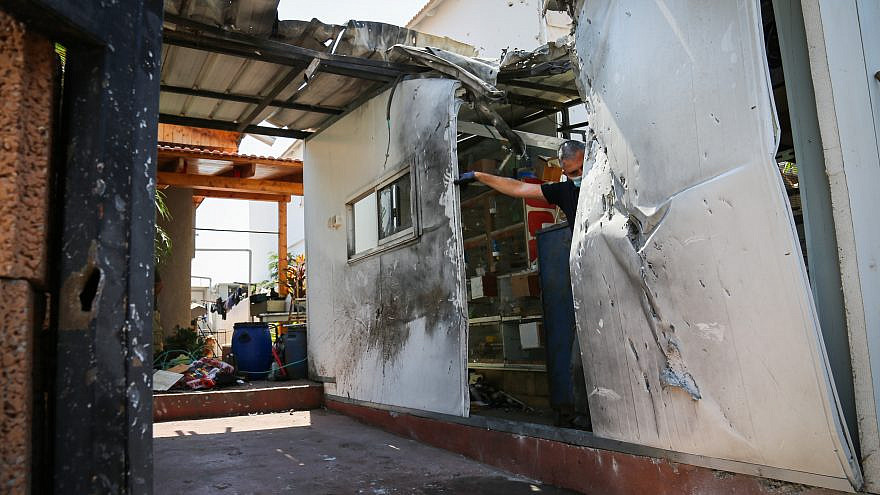 File photo: View of damage to a house caused by a rocket fired from the Gaza Strip in the southern Israeli city of Sderot on Aug. 16, 2020. Photo by Flash90.