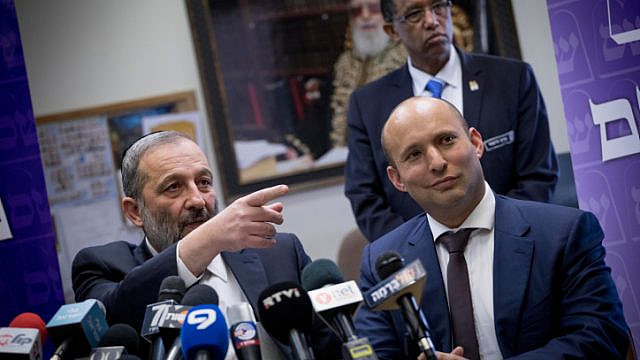 Israel Interior Minister Aryeh Deri with Education Minister Naftali Bennett during a Shas Party press conference at the Knesset, on Feb. 27, 2017. Photo by Yonatan Sindel/Flash90.