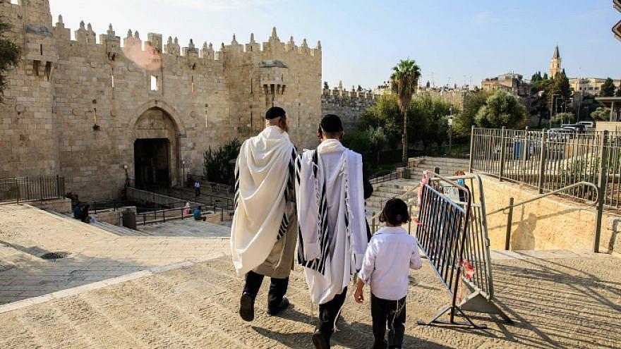 Ultra-Orthodox Jewish men walk through Damascus Gate in Jerusalem's Old City on Oct. 30, 2020. Photo by Sliman Khader/Flash90.