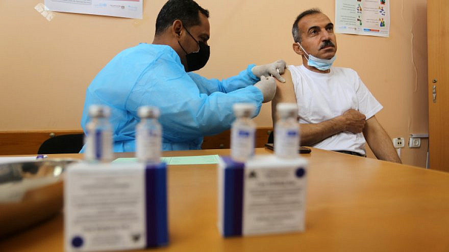 A medical worker administers a COVID-19 vaccine at the UNRWA clinic in Rafah in the southern Gaza Strip on March 3, 2021. Photo by Abed Rahim Khatib/Flash90.