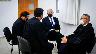Israeli Prime Minister Benjamin confers with his legal staff at the District Court in Jerusalem on April 5, 2021. Photo by Oren Ben Hakoon/POOL.