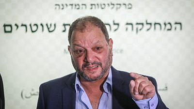 Joint Arab List Knesset member Ofer Cassif arrives at the Israel Police's Internal Investigations Department in Jerusalem, to file a complaint against officers who allegedly attacked him during a protest, April 11, 2021. Photo by Noam Revkin Fenton/Flash90.