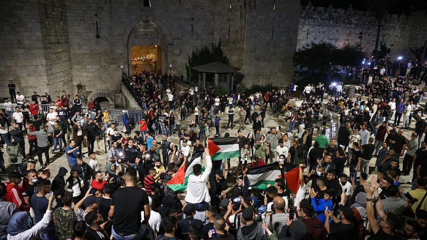 Arabs wave Palestinians flags at Damascus Gate in Jerusalem's Old City, April 25, 2021. Photo by Noam Revkin Fenton/Flash90.