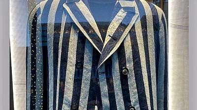 The fashion company Georgio Armani pulled an item from sale that resembled prison uniforms worn in concentration camps, April 2021. Source: Twitter.