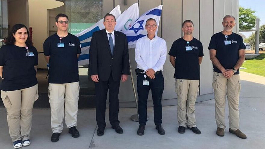 Uruguay's Ambassador to Israel Bernardo Griever (in suit) wishes the Sheba Medical Center team traveling to his home country a successful journey. Alongside him is Prof. Arnon Afek, the deputy director general of the hospital. Photo courtesy of Sheba Medical Center.