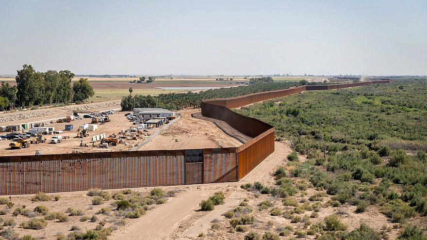 Construction on the new border wall system project near Yuma, Ariz., June 3, 2020. Credit: Jerry Glaser, U.S. Government Photo via Wikimedia Commons.