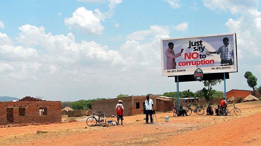A billboard in Zambia, 2005. Credit: Lars Plougmann from London, United Kingdom via Wikimedia Commons.