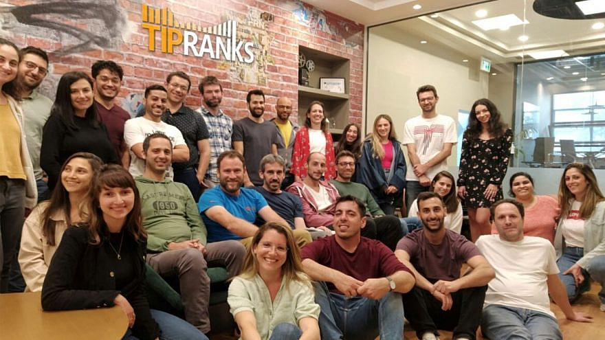 TipRanks employees celebrate a $77 million funding round in April 2021. Credit: TipRanks.